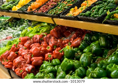Rows of peppers in a market. - stock photo
