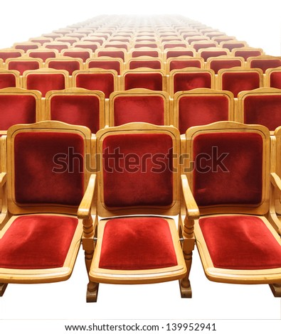 Rows of plush red seats in a theatre auditorium - stock photo
