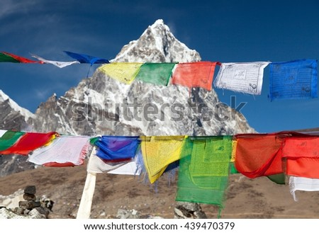 Rows of prayer flags and mount Arakam Tse sagarmatha national park, trek to Everest base camp - Nepal