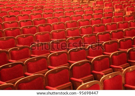 Rows of red chairs at the theater