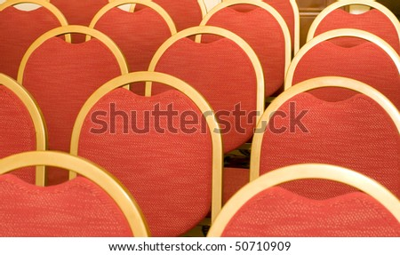 Rows of red Chairs for visitors in the conference hall - stock photo