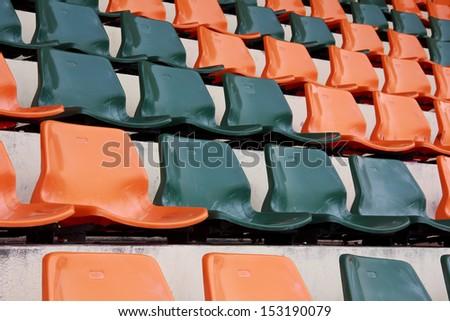 Rows of red mini-football stadium empty seats - stock photo