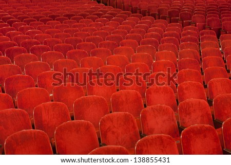 rows of red plush theater seating