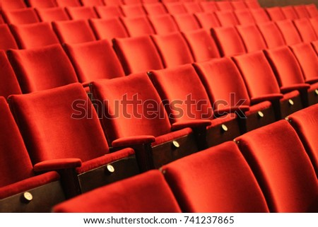 rows of red seats in a historic cinema