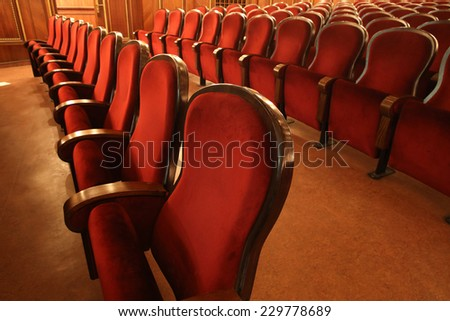 Rows of red wooden seats in theater or opera