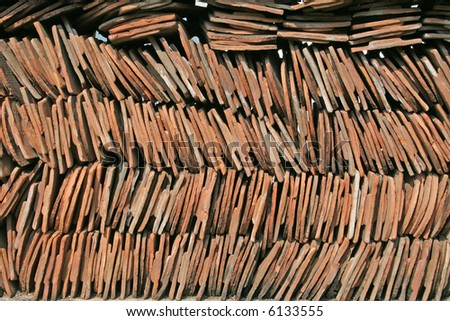 Rows of roof tiles stacked together, suitable as a background