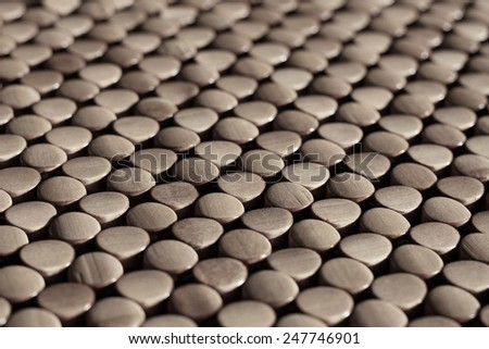 rows of round wooden circle of dots - stock photo