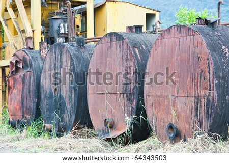 Rows of rusty oil drum - stock photo