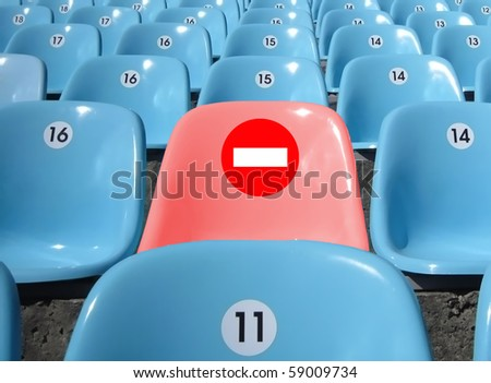 "Rows of seats at stadium. Convenient seat with sign ""journey is forbidden!"""