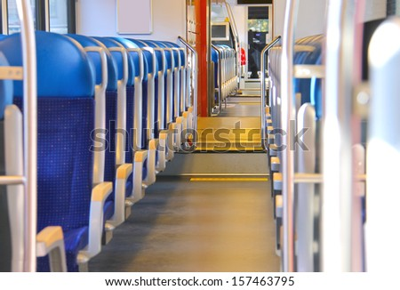 Rows of seats in a passenger train car. - stock photo