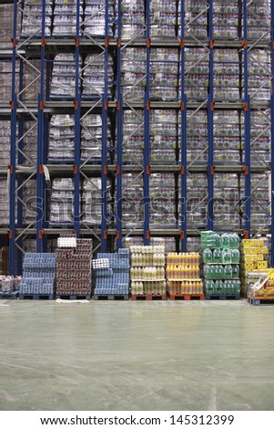 Rows of shelves with drinks in warehouse - stock photo