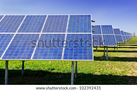 Rows of solar panels in small solar power plant - stock photo