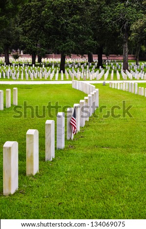 rows of soldiers tombstones on a national cemetery - stock photo