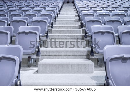 Rows of stadium seats ready in a new facility - stock photo