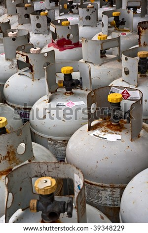 Rows of tanks filled with flammable gas. - stock photo