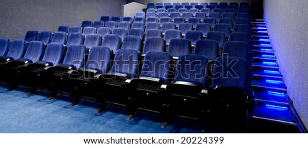Rows of theater seats - stock photo