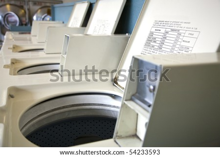 Rows of washers at a laundry mat - stock photo