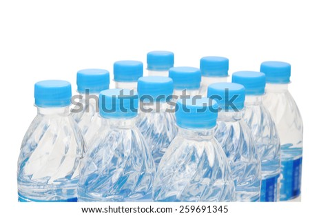 Rows of water bottles drinking on white background - stock photo