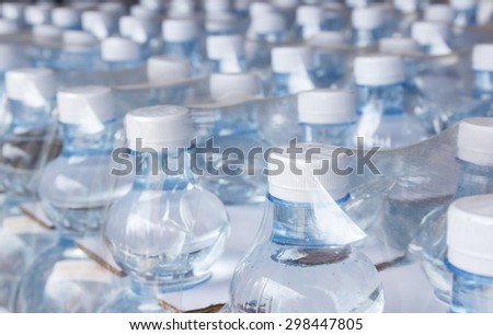 Rows of water bottles in plastic wrap - stock photo