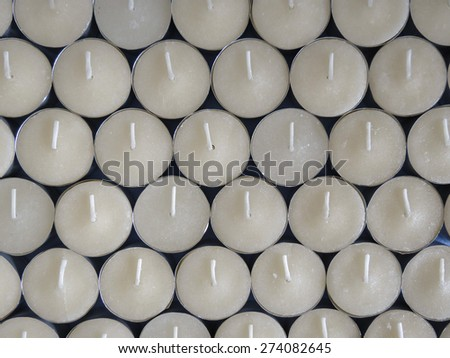 Rows of white wax tea light candles - stock photo