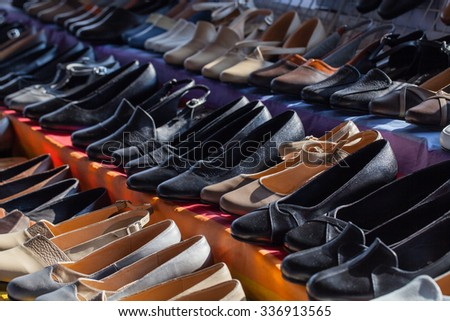 Rows of  woman shoes on  shelves in store - stock photo