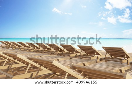 Rows of wooden chaise longues at the beach. 3D Rendering - stock photo