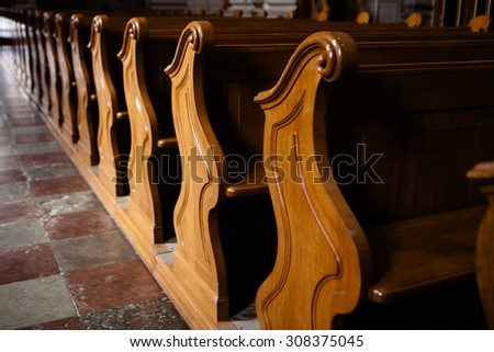 Rows of wooden church benches without anybody from close - stock photo