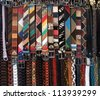 rows with lots of colorful belts - stock