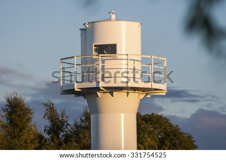 ROWY, POLAND - CIRCA SEPTEMBER 2015: lighthouse at the mouth of the harbor in Rowy circa September 2015 in Rowy.