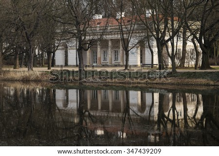 Royal Baths in Warsaw. Theater and pond with reflecting in the building.  - stock photo