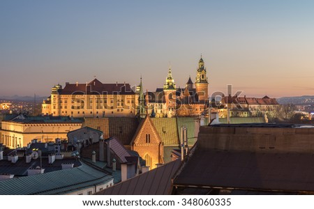 Royal castle and cathedral on the Wawel hill seen from the Town Hall tower in Krakow, Poland in the evening - stock photo