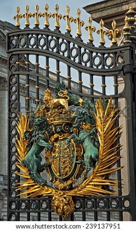 Royal Crest at Buckingham Palace Gate in London, United Kingdom - stock photo