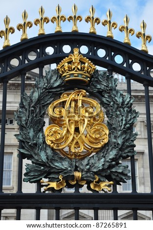 Royal Crest at the Buckingham Palace Gate in London - stock photo