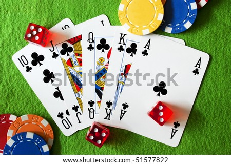 Royal flush, dices and poker chips - stock photo