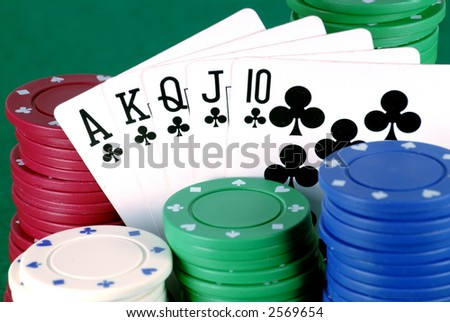 Royal flush in clubs among poker chips
