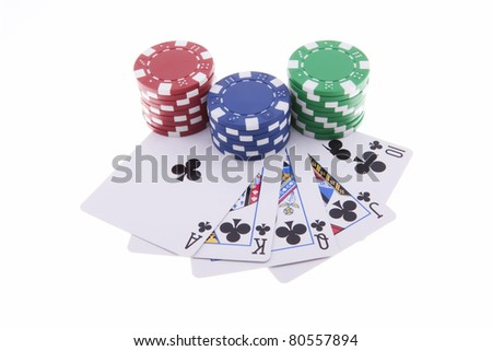 Royal Flush of clubs with poker chips isolated on the white background