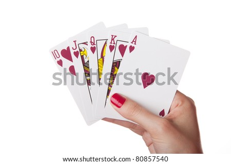 Royal Flush of hearts in hand isolated on the white background - stock photo