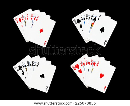 Royal Flush of spade,heart,diamonds,clubs in poker game on a black background - stock photo