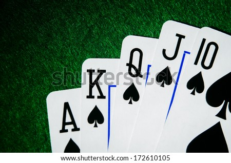 royal flush of spades. poker game. - stock photo