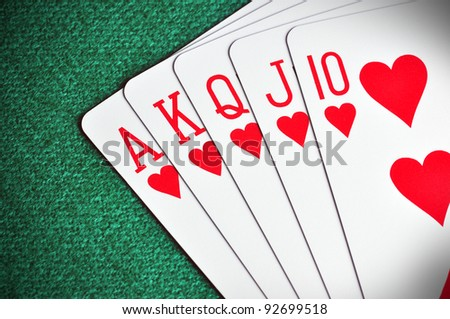 Royal Flush poker card sequence on a green table - stock photo