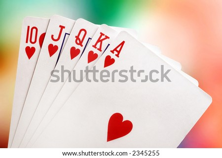 Royal flush with brightly-coloured background - stock photo