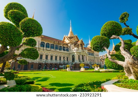 Royal Grand palace, Wat pra kaew with blue sky green grass, bangkok, Thailand - stock photo