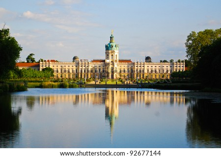 Royal Hohenzollern baroque and rococo Charlottenburg palace on the lake side with English gardens in Berlin, Germany - stock photo