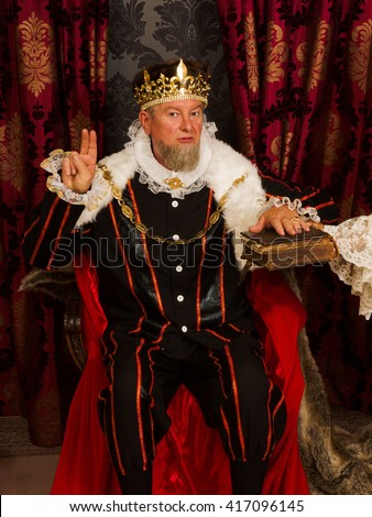 Royal king swearing a solemn oath at his inauguration - stock photo