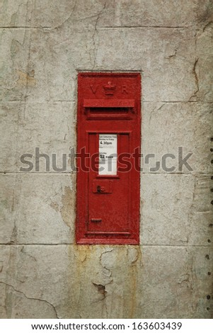 Royal mail box on a old wall.  Vintage style. - stock photo