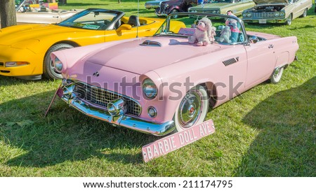 ROYAL OAK, MI/USA - AUGUST 15, 2014: A 1955 Ford Thunderbird car with a Barbie Doll theme at the Woodward Dream Cruise, the world's largest one-day automotive event and National Scenic Byway. - stock photo