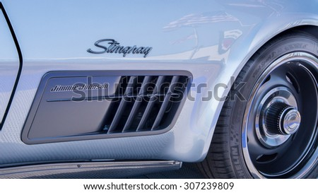 ROYAL OAK, MI/USA - AUGUST 13, 2015: American flag reflection in the Jimmie Johnson 1971 Chevrolet Corvette Concept car at the Woodward Dream Cruise. Woodward is a National Scenic Byway. - stock photo
