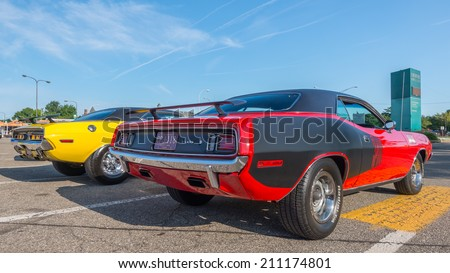 ROYAL OAK, MI/USA - AUGUST 15, 2014: Dodge Challenger and Plymouth 'Cuda (Barracuda) cars at the Woodward Dream Cruise, the world's largest one-day automotive event and a National Scenic Byway. - stock photo