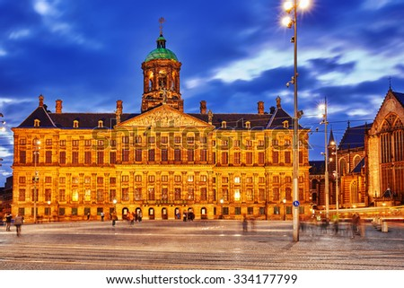 Royal Palace in Amsterdam on the Dam Square in the evening. Netherlands - stock photo