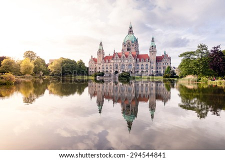 Royal palace reflecting in the water at sunset - stock photo